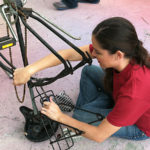 toymaker_fixing_bicycle